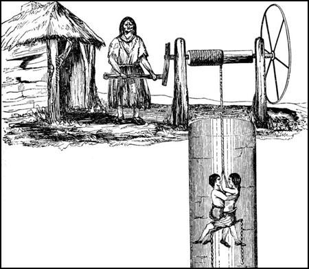 ex spartacus educational Woman lowering children to mine shaft 00coalEX2