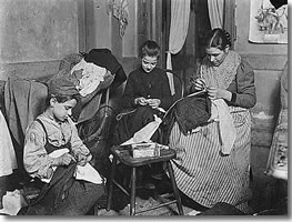 Photograph showing a Victorian family at work making trousers Image courtesy of wwweridingnet poorclothessml